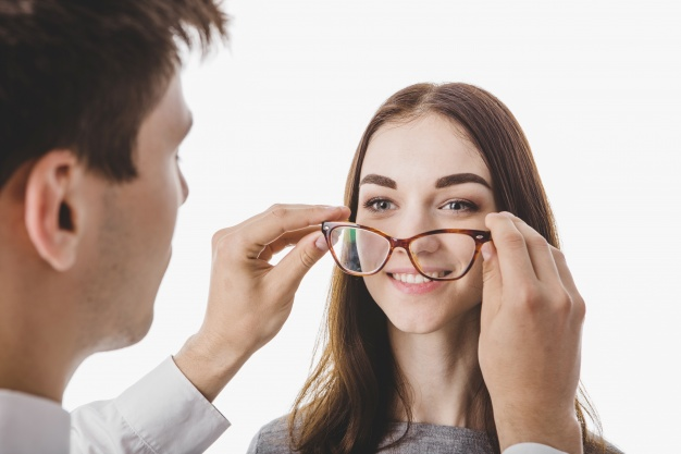 doctor-putting-glasses-woman_23-2147648736